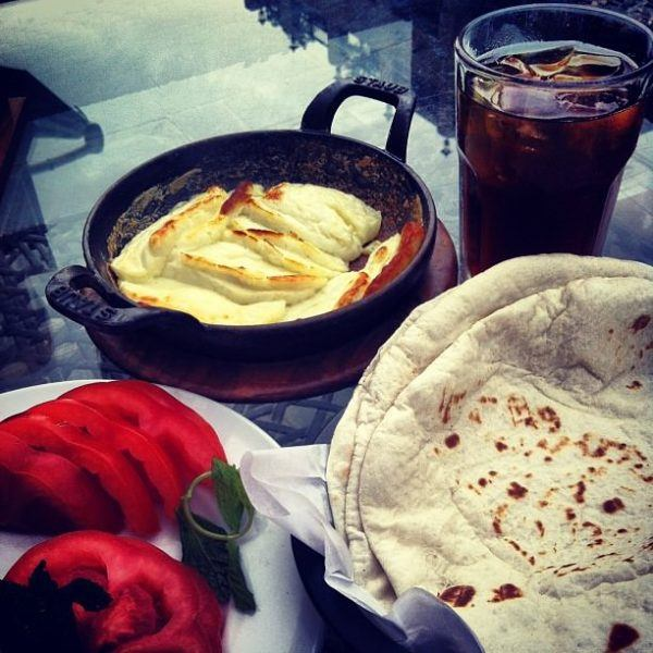 Arabic break, baked halloumi and fresh tomatoes with a side of ice tea. My Doha kind of meal!