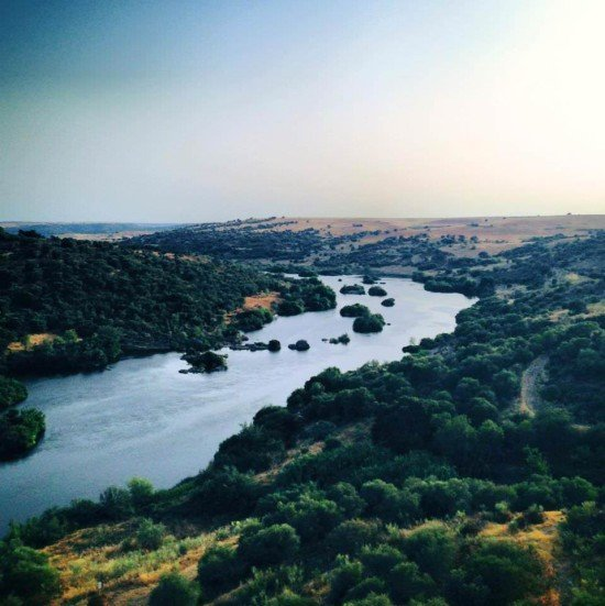 The Guadiana river which, further south, separates Portugal from Spain (when it reaches the Algarve)